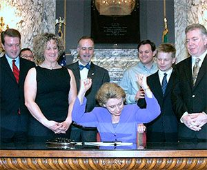 WA Governor Chris Gregoire (center) as she signs the Domestic Partnership Registry Bill alonside Charlene Strong (left).
